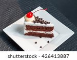 Cake On A Plate On Wooden Floor.