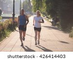 jogging couple warming up and... | Shutterstock . vector #426414403