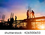 Silhouette engineer standing orders for construction crews to work on high ground  heavy industry and safety concept over blurred natural background sunset pastel