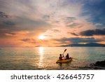 couple kayaking in sunset ... | Shutterstock . vector #426645757