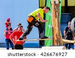 Small photo of Emmaboda, Sweden - May 13, 2016: Forest and tractor (Skog och traktor) fair. Kaha Nui Wood lumberjack sports show. Person chopping and climbing a standing log.
