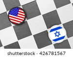 Small photo of Draughts (Checkers) - United States vs Israel - collaboration and rivalry between two strong allies with great power - problem of palestine state, zionism, peace on middle east