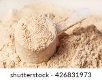 heap of whey protein powder | Shutterstock . vector #426831973