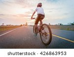 boy cyclist on the road in a... | Shutterstock . vector #426863953