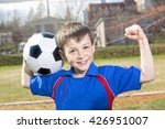 a handsome teenager boy play... | Shutterstock . vector #426951007