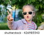 pretty little girl in sun... | Shutterstock . vector #426985543