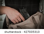 woman with concealed weapon | Shutterstock . vector #427035313