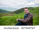 young happy man sitting on the... | Shutterstock . vector #427040767