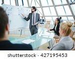 businessman presenting his... | Shutterstock . vector #427195453