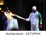 OTTAWA, CANADA - DECEMBER 12: Joe Juneau lighting the torch at the Olympic Torch Relay ceremony in preparation for the 2010 Winter Olympics.  Ottawa, December 12, 2009. - stock photo