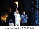 OTTAWA, CANADA - DECEMBER 12: Joe Juneau and PM Harper at the Olympic Torch Relay ceremony in preparation for the 2010 Winter Olympics.  Ottawa, December 12, 2009. - stock photo
