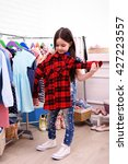 little girl trying on a new... | Shutterstock . vector #427223557