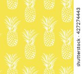 pineapples seamless on a... | Shutterstock . vector #427274443