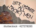 Small photo of Handwritten graffiti Let's Castrate All Macho Men sprayed on wall, anarchist aesthetics. Appeal to against masculinism, violence against women and rapes