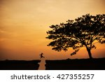 silhouette of man jumping over... | Shutterstock . vector #427355257