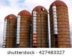 Four Old Rusty Grain Silos