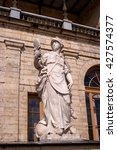 Small photo of Gatchina Palace. Sculpture at the front door. Allegory - prudence. Sculptor Johann Morleyter.