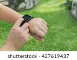 a woman looking at watch  smart ... | Shutterstock . vector #427619437
