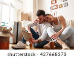 young couple moving in new home.... | Shutterstock . vector #427668373