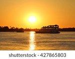 a houseboat cruises the zambezi ...   Shutterstock . vector #427865803
