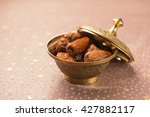 ripened dates in a metal bowl....   Shutterstock . vector #427882117