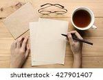 Female Hand Writing Down On...