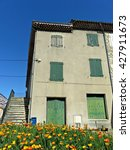 Small photo of LIVRON-SUR-DROME, FRANCE - MAY 5, 2016: Exterior of a house in the little town of Livron-sur-Drome in southern France.