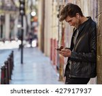 young man listening music with... | Shutterstock . vector #427917937