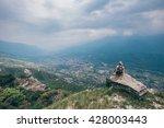 thinking woman hiker on a... | Shutterstock . vector #428003443