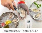 Shucking An Oyster As Water...