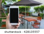 man's hand shows mobile... | Shutterstock . vector #428135557