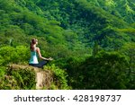 woman doing yoga over looking a ... | Shutterstock . vector #428198737