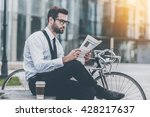 reading fresh news. side view... | Shutterstock . vector #428217637