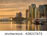Stock photo  coal harbor morning vancouver vancouver s city center and coal harbor at sunrise rowing 428217673