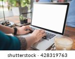 female working on laptop in a... | Shutterstock . vector #428319763