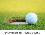 Close Up Golf Ball On Lip Of...