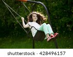 happy little girl on a swing in ... | Shutterstock . vector #428496157