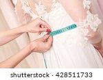 skillful designer fitting... | Shutterstock . vector #428511733