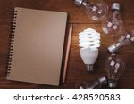 "Small photo of Energy saving lamp and incandescent lamp and ""save energy"" word on wooden background. Concept for saving energy, eco-friendly, global warming."