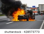 Small photo of A car is ablaze on the highway