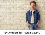 Stylish Little Boy In Jeans...