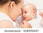close up portrait. mother and... | Shutterstock . vector #428590447