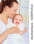 portrait mom and baby.closeup. | Shutterstock . vector #428591413