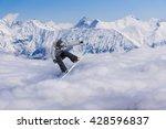 Snowboard Rider Jumping On...