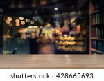wooden empty table top with... | Shutterstock . vector #428665693