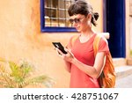 girl walking and texting on the ... | Shutterstock . vector #428751067