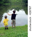 boys by lake - stock photo