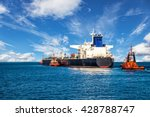 Tugboat Towing A Tanker Ship A...
