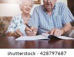 Senior Couple Signing Will...