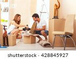 happy couple moving in new... | Shutterstock . vector #428845927